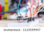 breadboard connected to arduino.... | Shutterstock . vector #1115559947