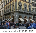 people walk in the old town.... | Shutterstock . vector #1115581955