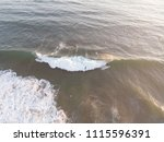 group of surfers looked from... | Shutterstock . vector #1115596391