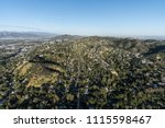 aerial view of hillside homes... | Shutterstock . vector #1115598467