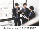 group of businessmen talking in ... | Shutterstock . vector #1115621519