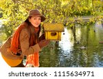 a young beautiful girl in a hat ... | Shutterstock . vector #1115634971