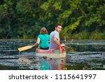 canoeing in beautiful natural...   Shutterstock . vector #1115641997