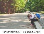 sad and unhappy school kid... | Shutterstock . vector #1115656784