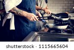 chef cooking food in the... | Shutterstock . vector #1115665604