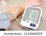man check blood pressure... | Shutterstock . vector #1115666525