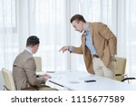 boss giving instructions to his ... | Shutterstock . vector #1115677589