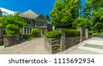 luxury house in the suburbs of... | Shutterstock . vector #1115692934