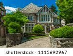 luxury house in the suburbs of... | Shutterstock . vector #1115692967