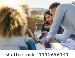 business team sitting on sunny... | Shutterstock . vector #1115696141
