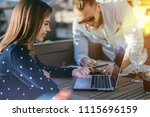 smiling female assistant gives... | Shutterstock . vector #1115696159