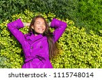 happy spring girl lying on... | Shutterstock . vector #1115748014