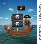 Small photo of The cat pirate in a tricorn with a knife is on a sailing ship in the open sea.