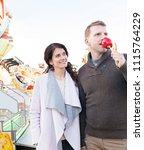 beautiful tourist couple... | Shutterstock . vector #1115764229