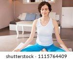beautiful woman sitting in yoga ... | Shutterstock . vector #1115764409