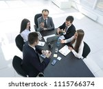 Stock photo from the top view business team discussing a problem with a business 1115766374