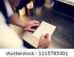 Closeup Of Chef Hand Writing...