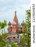 Small photo of Moscow, Russia, 06.12.2018. View of St. Basil's Cathedral through the green foliage of Zaryadye Park. Cloudy sky, magnificent temple