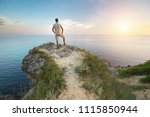 Man Stands On The Edge Of The...