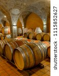 view at old barrels in the wine ... | Shutterstock . vector #1115852627