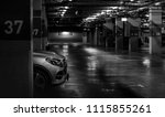 Car parking in the shopping mall. Silver car parked at block 37 overnight. Indoor car parking. Automobile parking space. Underground car parking lot. Robbery auto parked in a deserted place concept. - stock photo
