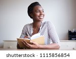 portrait of smiling young black ... | Shutterstock . vector #1115856854