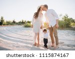mother and father kissing while ... | Shutterstock . vector #1115874167