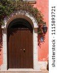 beautiful door decorated with... | Shutterstock . vector #1115893721