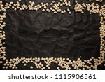 chickpea frame on crumpled... | Shutterstock . vector #1115906561