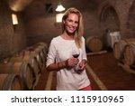 beautiful woman oenologist... | Shutterstock . vector #1115910965