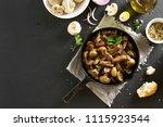 tasty beef stroganoff with... | Shutterstock . vector #1115923544
