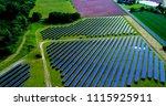 solar panels in aerial view | Shutterstock . vector #1115925911