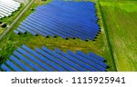 solar panels in aerial view | Shutterstock . vector #1115925941