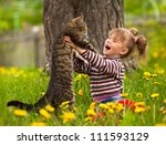 Stock photo kid playing with a cat 111593129