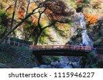 minoh waterfall in autumn...   Shutterstock . vector #1115946227