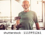 smiling senior man with weight... | Shutterstock . vector #1115951261