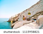 turquoise sea stone beach at... | Shutterstock . vector #1115958821