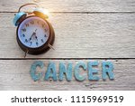 retro clock and cancer word... | Shutterstock . vector #1115969519
