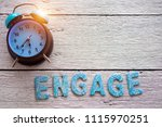 retro clock and engage word... | Shutterstock . vector #1115970251
