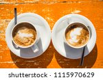 Small photo of Two invigorating cappuccinos on the table await you