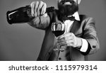 glass and bottle of red wine in ... | Shutterstock . vector #1115979314