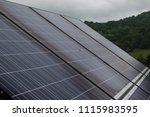 photovoltaic panels on a cloudy ... | Shutterstock . vector #1115983595