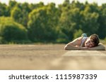 Young adult male laying outside in the sunshine - stock photo