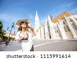 young woman tourist making... | Shutterstock . vector #1115991614
