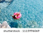 pretty woman lying on floating... | Shutterstock . vector #1115996069
