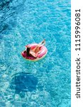 pretty woman lying on floating... | Shutterstock . vector #1115996081
