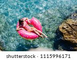 pretty woman lying on floating... | Shutterstock . vector #1115996171