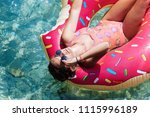 pretty woman lying on floating... | Shutterstock . vector #1115996189