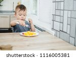 a child in a t shirt in the... | Shutterstock . vector #1116005381
