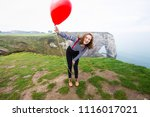 smiling happy girl with a red... | Shutterstock . vector #1116017021